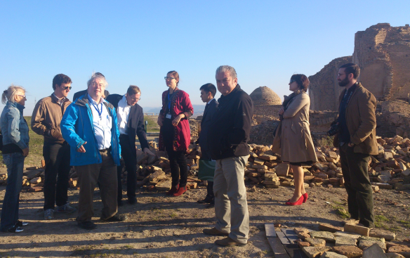 Hiebert lecturing on top of the Anau South tell during a conference in Turkmenistan in November of 2014